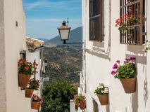 Elevated view of houses on The edge of town and surrounding countryside, Olvera, Cadiz Province, Andalusia, Spain, Western Europe.  royalty free stock image