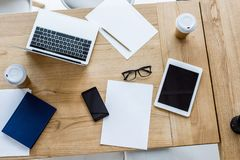 elevated view of laptop, smartphone and tablet on table royalty free stock photos