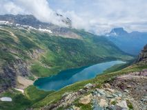 Elevated view looking down on a lake in the mountains of Glacier stock photos