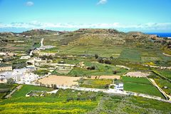 Gozo countryside and buildings during the Spring. Elevated view looking North at the surrounding countryside seen from the citadel, Victoria Rabat, Gozo, Malta Royalty Free Stock Images