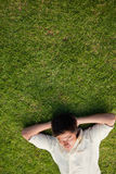 Elevated view of a man lying with his eyes closed and his head r Royalty Free Stock Photo