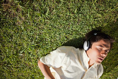 Elevated view of a man using headphones to listen to music  Royalty Free Stock Image