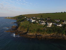 Elevated view of mevagissey Bay in Cornwall. Image taken by a DJI Inspire Drone over the bay of Mervergissey, the sea lapping up over the rocks around the Stock Photo