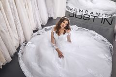 Elevated view, one person, bride lying on floor in gown. Bridal salon Stock Images
