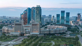 Elevated view over the city center and central business district day to night Timelapse, Central Asia, Kazakhstan stock footage