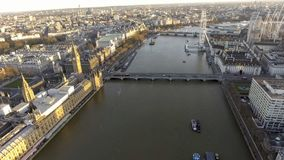 Elevated view over the City of London along the River Thames. At Sunset. Big Ben Westminster Palace Parliament, St Thomas Hospital, Eye Observation Wheel on the royalty free stock photos