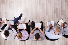 Elevated View Of People Reading Holy Book royalty free stock images