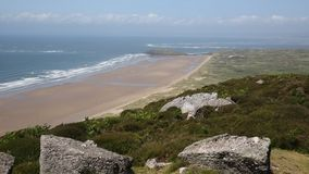 Elevated view of Rhossili beach The Gower peninsula UK stock video footage