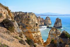 Rugged coastline at Ponta da Piedade. Stock Photography
