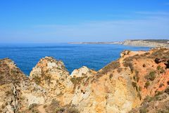 Rugged coastline at Ponta da Piedade. Stock Photos