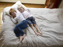 Elevated View Of Sisters Sleeping In Bed Royalty Free Stock Images
