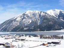 Elevated view of ski village. With frozen lake and mountain backdrop Royalty Free Stock Photos