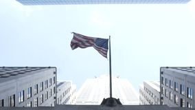 Elevated view of the skyscrapers and national american flag in New York. Office building and skyline in city center. Elevated view of the skyscrapers and stock video footage