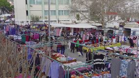 Elevated view of street vendors selling products at large bazaar flea market in Xanthi, Greece. stock footage