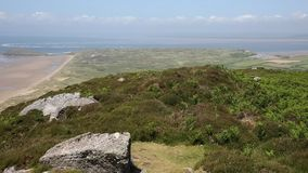 Elevated view top of Rhossili Down mountain The Gower peninsula UK PAN stock footage