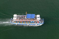 Elevated view of tourist boat in Estacio Maritima, harbor of Barcelona, Spain Royalty Free Stock Images