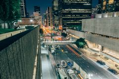 Downtown Los Angeles at night. Elevated view of traffic driving down street in downtown Los Angeles at night, California, US Stock Photo