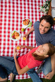 Elevated view of two smiling friends as they lie on a blanket wi Stock Image