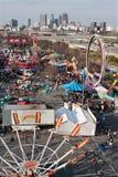 Elevated View Of Urban Fairgrounds Shows Atlanta City Skyline. Atlanta, GA, USA - March 15, 2014:  Elevated wide shot of annual Atlanta Fair, with city skyline Stock Photography