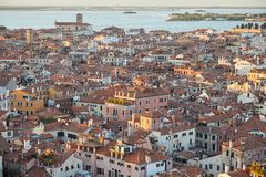 Elevated view of Venice with roofs buildings and sea, Italy. Elevated view of Venice with roofs buildings and sea before sunset, Italy royalty free stock photography