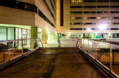Elevated walkway and buildings at night in Baltimore, Maryland. Royalty Free Stock Images