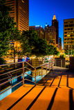 Elevated walkway and buildings at night in Baltimore, Maryland. Stock Image