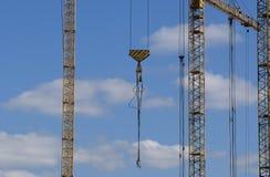 Elevating construction crane Stock Photos