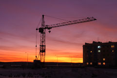 Industrial crane at sunset Royalty Free Stock Image
