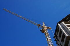 Elevating crane against the dark blue sky Stock Image