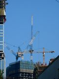 Elevating cranes. Building. Royalty Free Stock Photography