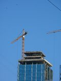 Elevating cranes. Building. Stock Photo