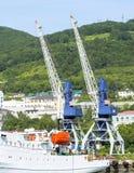 Elevating cranes in sea port on Kamchatka Royalty Free Stock Photo