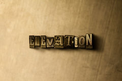 ELEVATION - close-up of grungy vintage typeset word on metal backdrop Royalty Free Stock Photo