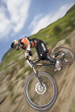 The elevator. Downhill mountain biker with speed blur stock images