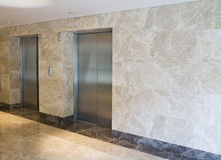 Elevator. Door and marble wall of  hotel Royalty Free Stock Image