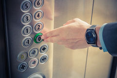 Elevator, button, one, first, action, floor, call, hand, lift, f Stock Photos