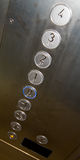 Elevator buttons. Stainless steel round elevator buttons Stock Photo