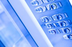 Elevator buttons. Blue toned image of elevator buttons Royalty Free Stock Photo