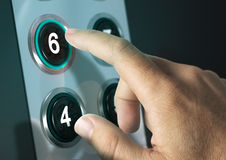 Elevator Buttons. With finger pressing the number six, concept of choice Royalty Free Stock Image