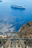 The elevator on the cliffs of Santorini. Against the blue of the sea Royalty Free Stock Images