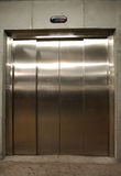 Elevator door. Closed door on stainless elevator, lift located in basement two Stock Photo