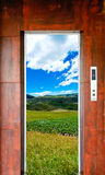 Elevator door and landscape. View Royalty Free Stock Photo