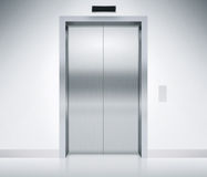 Elevator Doors Closed. Modern elevator or lift doors made of metal closed in building with lighting Stock Photography