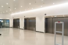 Elevator at hallway of the modern building. Three close elevator for pass sent nearly entrance at  hallway in modern building,  shopping mall or luxury place and Stock Images