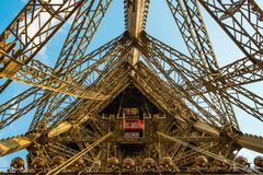 Elevator shaft on the eiffel tower in a wide angle shot. Stock Photos