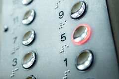 Elevator keypad. Close up of elevator keypad with glowing button Royalty Free Stock Photo