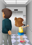 An elevator with a man and a young girl Stock Images
