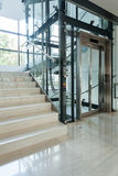 Elevator next to staircase Stock Images