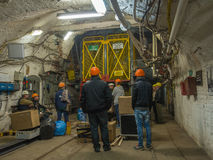 Elevator. Ruda Slaska, Poland - November 05, 2015:  People wearing  helmets waiting for an elevator to a shaft in a coal mine Stock Image