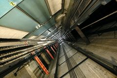 Elevator Shaft. The view up inside a tall elevator shaft Royalty Free Stock Photography